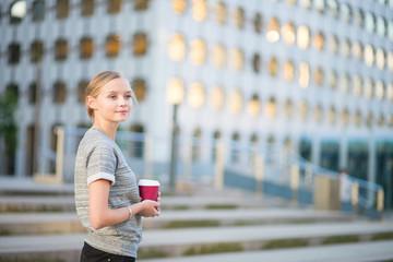 Young woman having her coffee break