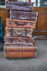 Old suitcases on trolleys in a station