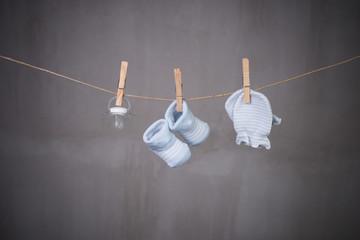 baby goods hanging clothesline
