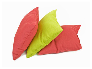 Stack of three cushions or pillows isolated on white background