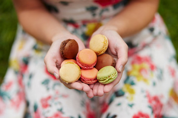 Girl holding colorful French macaroons