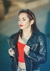 Young fashion hipster beautiful girl in leather jacket