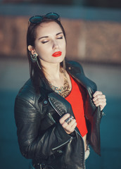 Young fashion hipster beautiful girl in leather jacket outdoor
