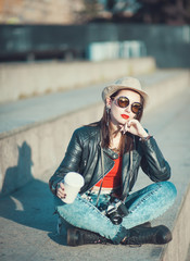Young fashion hipster beautiful girl in leather jacke with retro