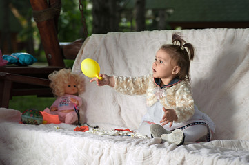 Happy child playing with a ball