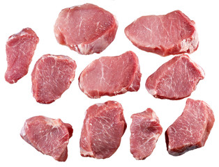 Cut a piece of fresh meat for cooking. Isolated.