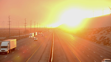 Time Lapse of Traffic on Highway with Fire Smoke Sunset
