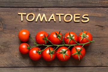 Cherry tomatoes and word Tomatoes
