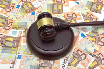 gavel lying on the background of the euro