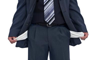 Geschäftmann mit leeren Taschen