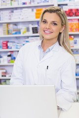 Smiling pharmaacist looking at camera