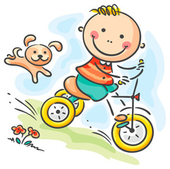 Boy riding his tricycle