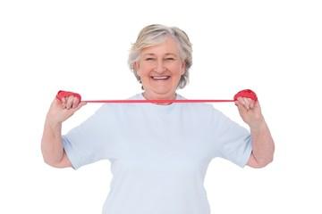 Senior woman using resistance band