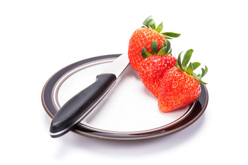 fresh garden strawberries on a white plate