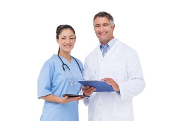 Doctor and nurse smiling at camera