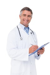 Happy doctor writing on clipboard