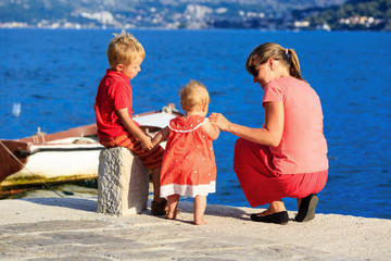 mother with kids on sea vacation
