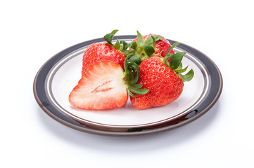 fresh garden strawberries on a white plate