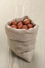 sack bag full of hazelnut kernels, rustic style photo