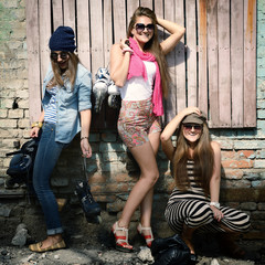 Portrait of attractive happy girls with roller skates, instagram