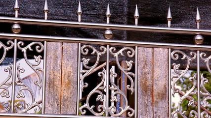 Ornamental metal fence. Video shift motion