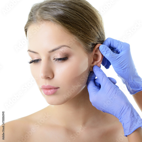 Young woman face with beauty treatment ear plastic isolated - 78886941
