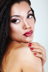 Young mulatto fresh woman with beautiful makeup, isolated on whi