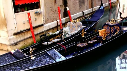 Two old  gondolas in the small canal of Venice
