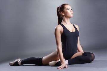 Blue-eyed ballet dancer posing in studio