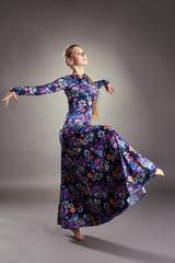 Graceful female dancer posing in stylish dress