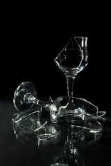 Broken Wine Glasses with Reflection on a Glass Table Isolated