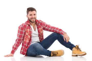 Relaxed man in lumberjack shirt