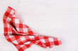 red checkered napkin on wooden background - 78889773