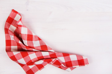 red checkered napkin on wooden background