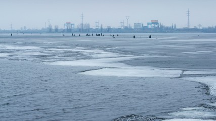 4k timelapse of many winter fishermen angling on ice