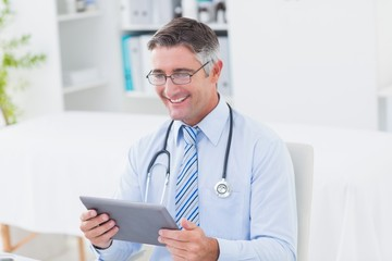 Male doctor using tablet computer