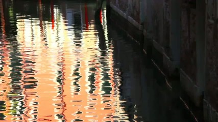 Evening reflection on the water of canal. Venice. Italy