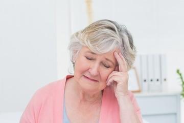 Senior patient suffering from headache