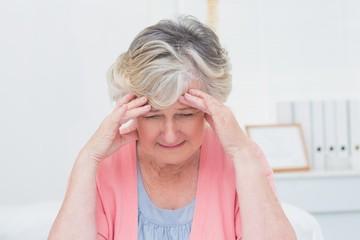 Tensed senior patient suffering from headache