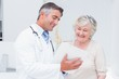 Doctor and patient discussing over reports - 78890775