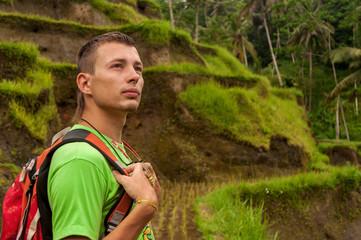 Man trekking on the rice fields