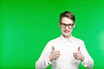young man in glasses shows thumbs up