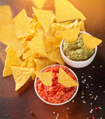 Guacamole with nachos in freeze motion