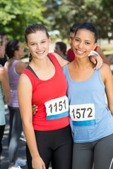 Fit women before race in park
