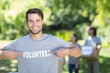 Leinwanddruck Bild - Happy volunteer in the park