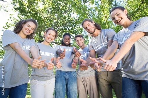 Leinwanddruck Bild Happy volunteers in the park