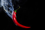 Smoking red hot chili pepper on black background - 78892936
