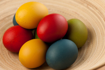 Colorful easter eggs decorated on color background