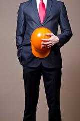 Men in suit with safety helmet