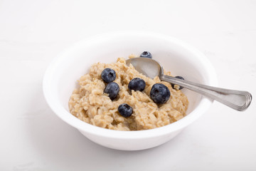 Oatmeal with Blueberries and Spoon in Bowl